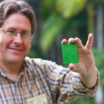 Phil holds a miniature book at auction