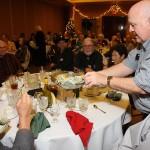 Registrar Jim Macklin collects the gratuity to thank Almansor