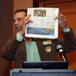 Deputy Sheriff Larry Boerio showing LA Times front page article on member Ernie Marquez.