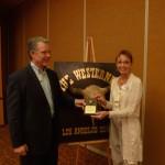 Deputy Sheriff Paul McClure and August Speaker Geraldine Knatz